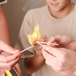 Warning Signs of young kids setting Fire.